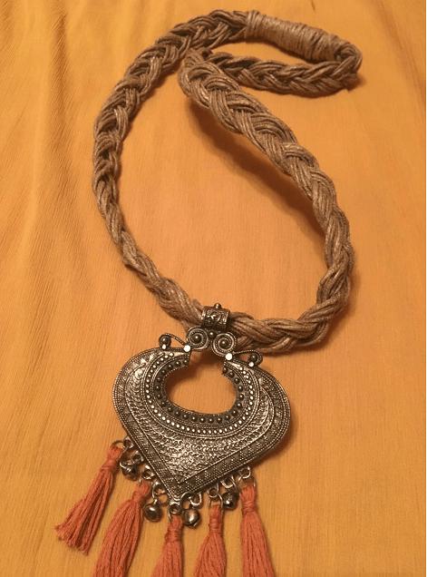 Braided  Jute Neckpiece with metal pendant.