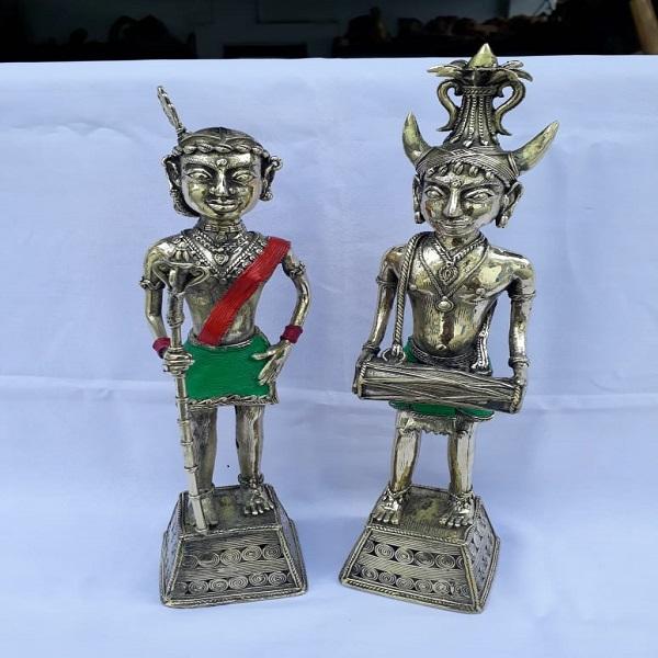 Handmade metal statue of a tribal couple.