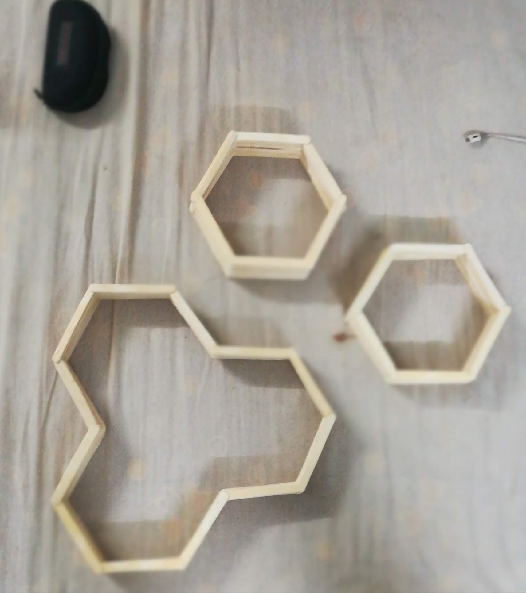 Hexagonal wood sticks wall art