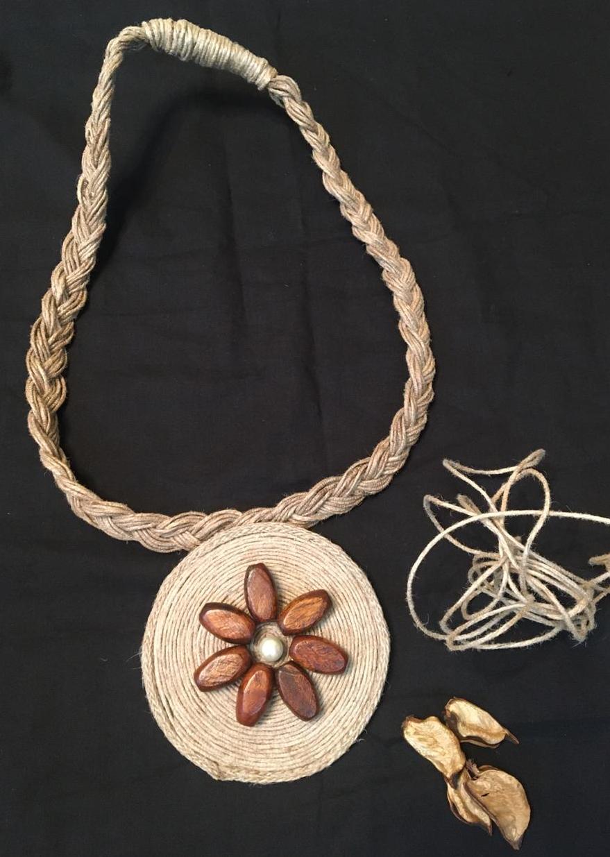 Neckpiece with wooden flower
